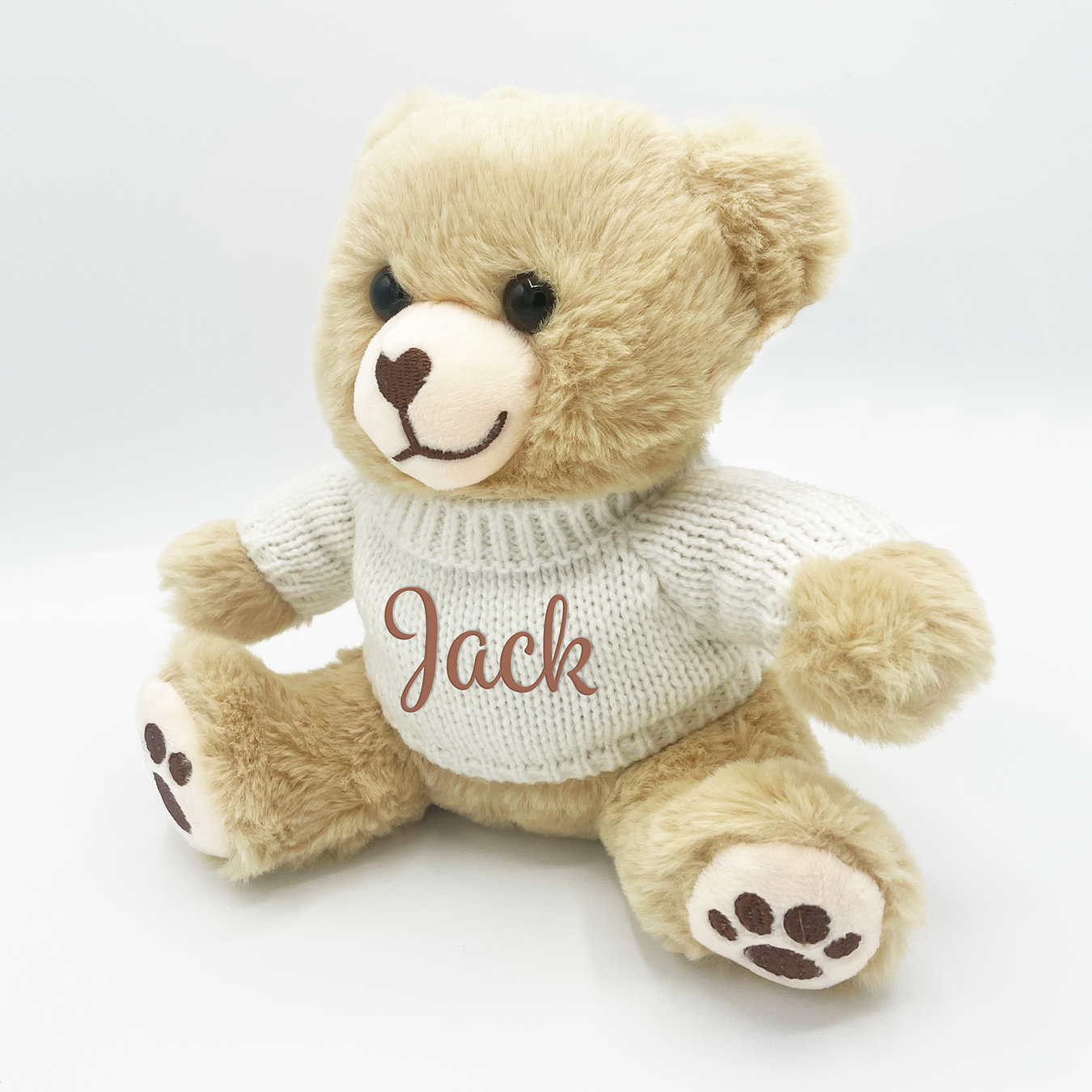 Brown teddy bear with sweater