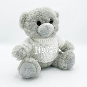 Grey teddy bear with sweater