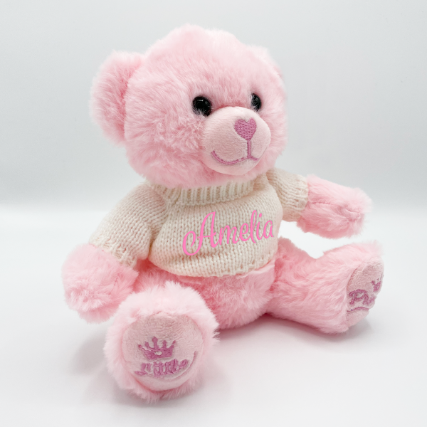 Pink teddy bear with sweater