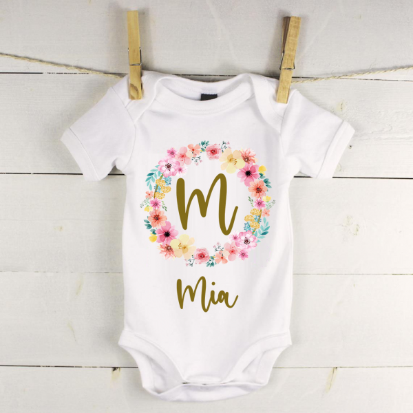 Personalised baby vest with wreath